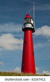 Red Lighthouse with a cloudy sky