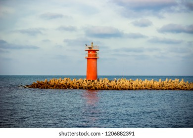 Red Lighthouse of Damietta with beautiful sky and clouds with twilight near Ras ElBar at the meeting point between the Mediterranean sea and the Nile in North Egypt -  مصر دمياط