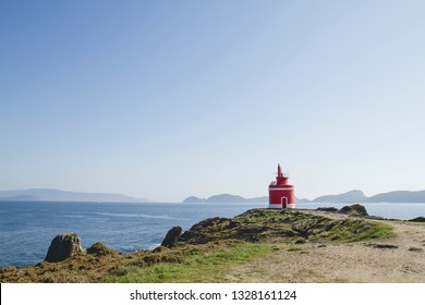 Red lighthouse in Home Cape, Pontevedra, Galicia, Spain