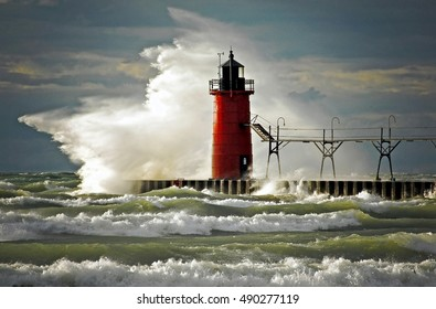 red lighthouse and pier in South Haven Michigan with wild wave