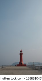 a red lighthouse in the sea