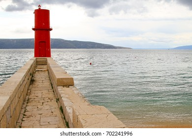 Red lighthouse tower at island Cres in Adriatic sea