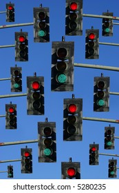 red lights and green lights on a sky blue background