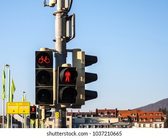 Red lights for pedestrians and cyclists with a graduated blue sky as background and copy space.