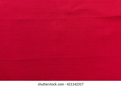 "Red linen ""waffle"" tablecloth picnic texture. Textile, napkin, tablecloth. View from above, top. Traditional pattern and color."