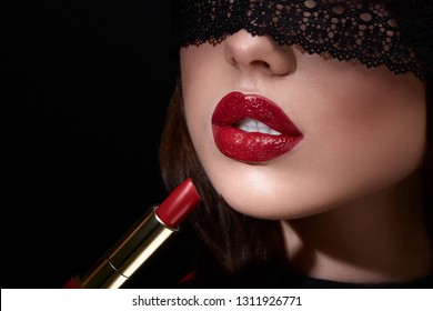 Red lips. Closed eyes. Close up portrait.