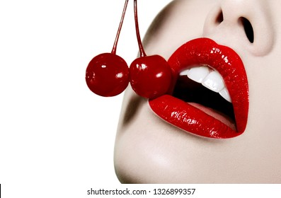 Red lips close-up with bright red cherries at the mouth. beautiful white teeth.perfect teeth, health, dentist, beauty salon.