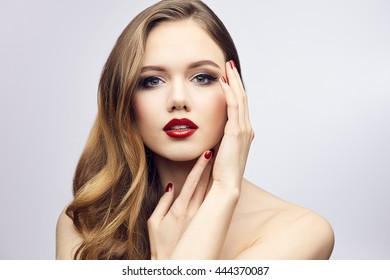 Red lips girl touching her face