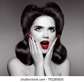 Red lips and manicured nails. Surprised pin up girl holds cheeks by hand. Comic woman with curls retro hairstyle. Wow expression.