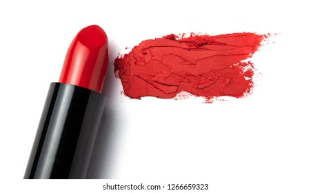 Red lipstick bullet smudged on white isolated. Copy space for text