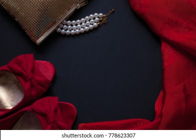 Red lipstick, lacquer, silk handkerchief on a black background. Valentine's Day
