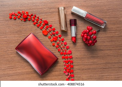Red lipstick, lip gloss and powder box on a wooden background