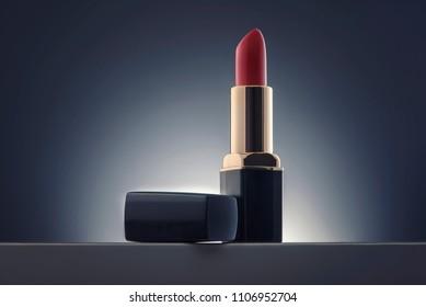 red lipstick over gradient background
