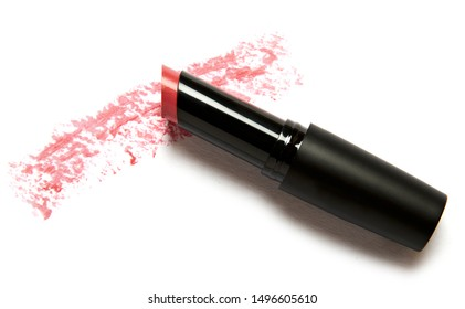 red lipstick package with smeared product isolated on white background
