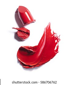 Red lipstick and smear isolated on white background