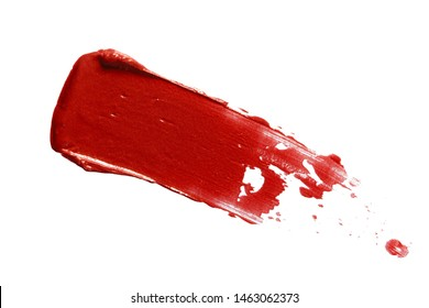 Red lipstick smear smudge swatch isolated on white background. Cream makeup texture. Macro cosmetic product stroke swipe sample