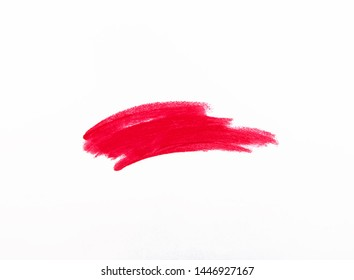 Red lipstick smudge isolated on white background close-up
