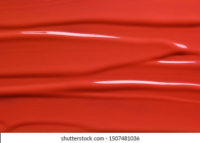 Red lipstick texture background. Beauty cosmetic product or paint sample. Liquid lipstick or lip gloss smear smudge stroke - Shutterstock ID 1507481036