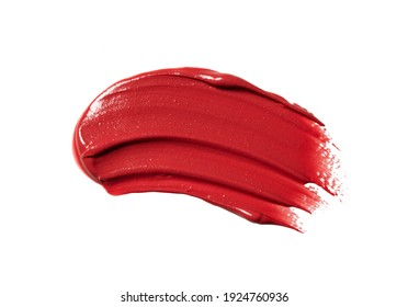 Red lipstick texture on white background. Cream makeup texture. Bright red cosmetic product brush stroke sample.