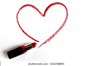 red lipstick write heart line on white backgound.