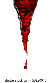 Red liquid pouring from inverted bottle