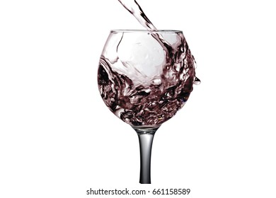 Red liquid, water, cherry juice, strawberry juice, red wine pouring into a glass, liquid in a speaker, isolated on a white background