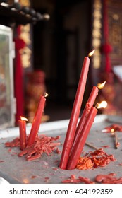 Red lit candles photographed at a temple in Melaka, Malaysia.