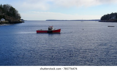 Red lobster boat in Rockport Maine harbor