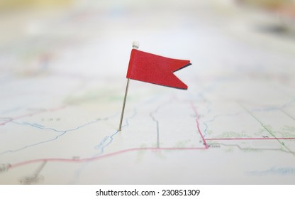 Red locator flag on a map