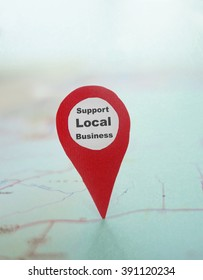 Red locator symbol with Support Local Business text on a map