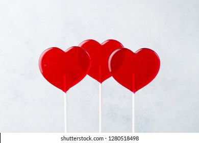 Red lollipops. Red hearts. Candy. Love and sweet concept. Valentine day. White background.