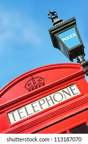 Red London Phone Box and old-fashioned Police satation sign