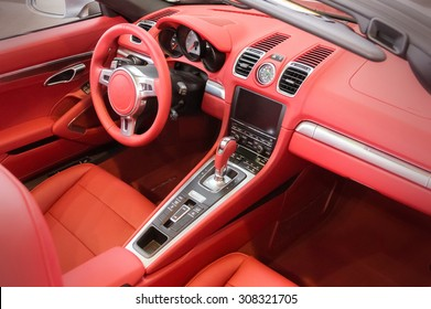 Red luxury car Interior - steering wheel, shift lever and dashboard