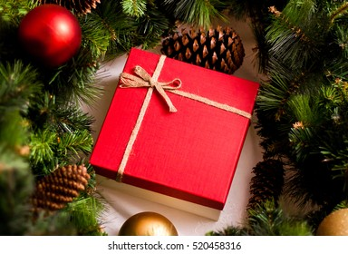 Red luxury New Year gift. Christmas gift. Happy New Year 2019. Christmas background with gift box. Christmastime celebration.