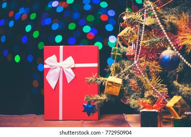 Red luxury New Year gift. Christmas gift. Happy New Year 2018. Christmas background with gift box. Christmastime celebration.