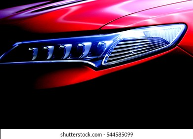 Red Luxury Sports Car Front Hood Light Close Up
