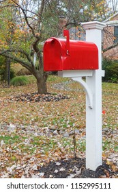 Red mailbox in front of the porch