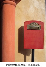 red mailbox on fresco wall background