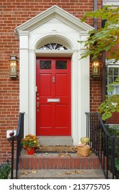 Red main door in Autumn