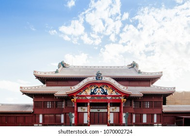 Red Main hall of Shuri (Shurijo) Castle under clear blue sky with tourists, Naha, Okinawa, Japan