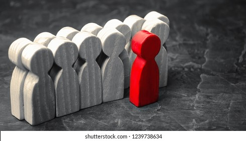 Red man coming out of the crowd. The chosen person among others. A talented worker. Promotion. Concept of search for a worker. The dismissal of an employee. Demotion. Human Resource Management