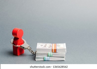 A red man is handcuffed to a money. Dependence on finance. Accumulated debts. Inability to repay loans. Unconscionable terms of the contract. Ban debtors from leaving the country. Unconscionability