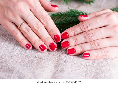 Red manicure and Christmas tree