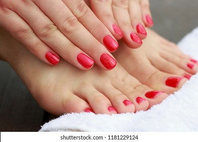 Red manicure and pedicure