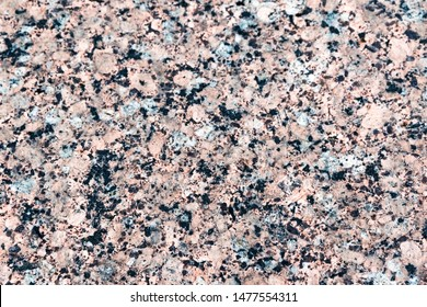 Red marble terrazzo flooring pattern. Texture of mosaic floor with natural stones, granite, marble, quartz, limestone, concrete. Polished rock surface. Natural background