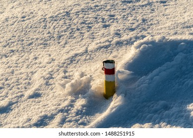 red marked hiking trail cairn with snow around in winter Martinske hole in Mala Fatra mountains in Slovakia