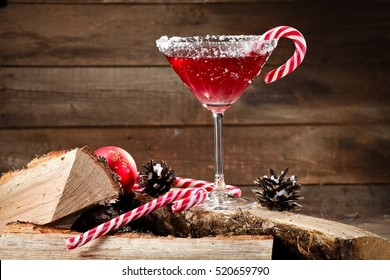 Red martini with Xmas candies on firewood
