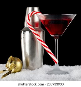 Red martini with Xmas lollipop and frozen shaker