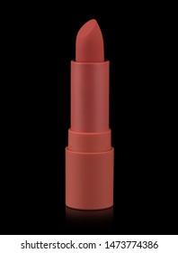 Red matte lipstick isolated on black background. Velvet satin airy lip stick new open.