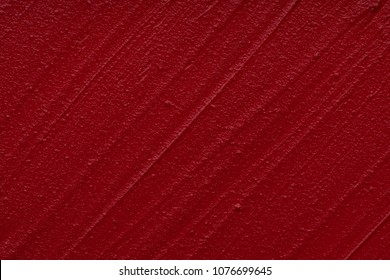 Red matte texture of lip gloss background. Red creamy lipstick texture background